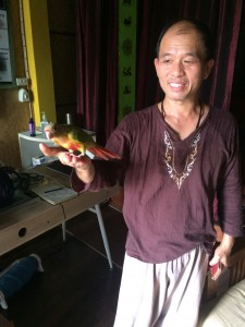 Chai with his pet bird